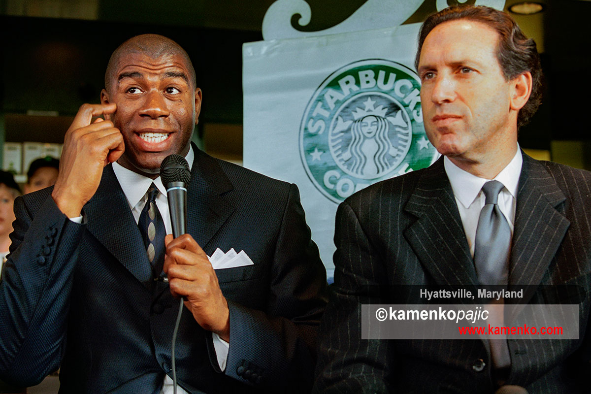 Howard Schultz, chairman and CEO of Starbucks Coffee Company(right) listen to NBA great, Earvin