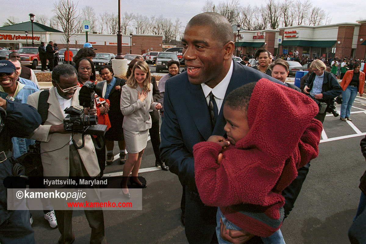 NBA great, Earvin Magic Johnson greeting bystanders