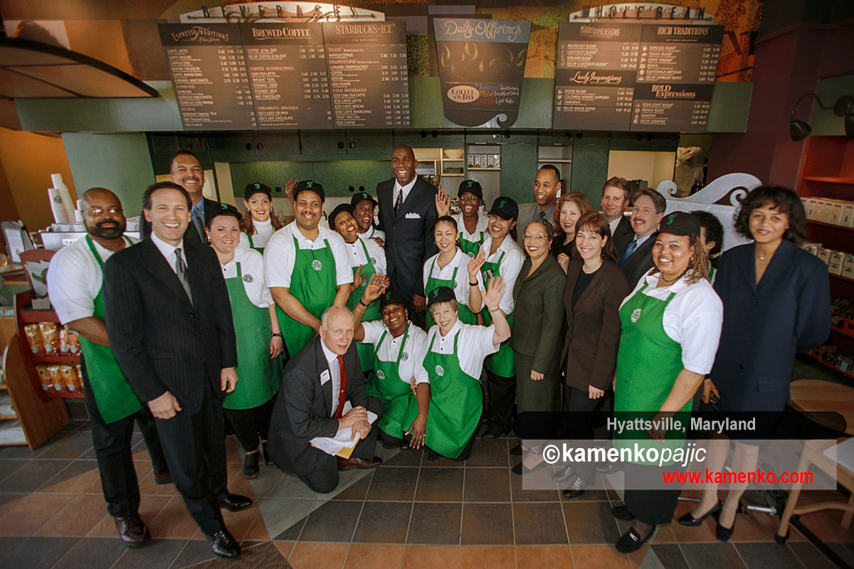 Howard Schultz, chairman and CEO of Starbucks Coffee Company, left, and NBA great, Earvin Magic Johnson with a stuff