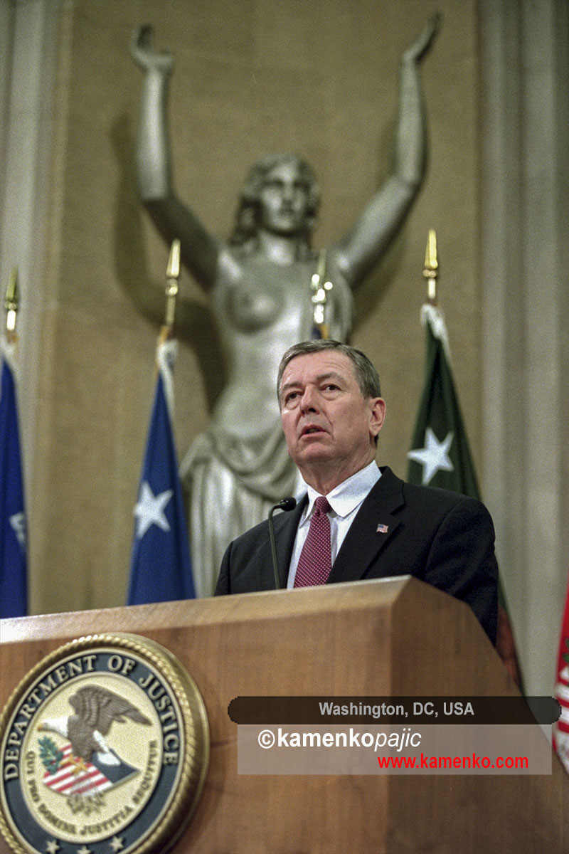 With the Spirit of Justice statue behind him, US Attorney General John Ashcroft addresses employees at the Justice Department in Washington on November 8, 2001
