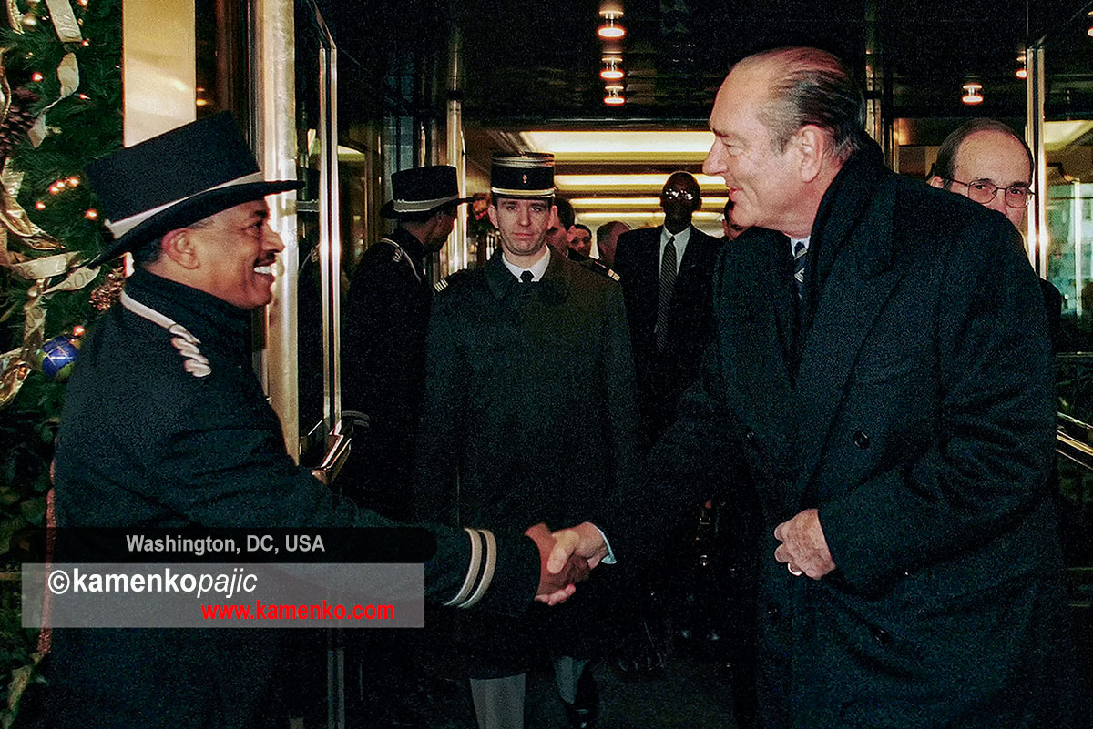President Chirac shakes hands with a doormen