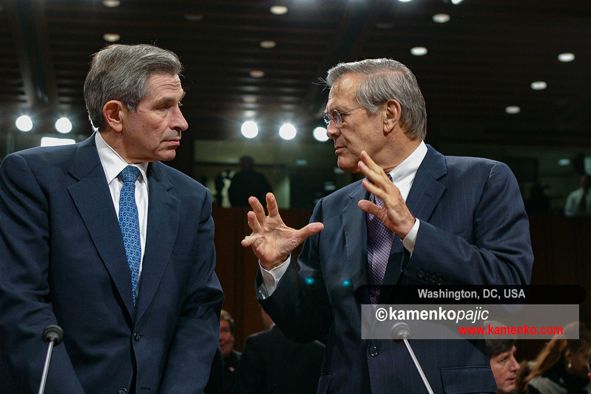 Paul Wolfowitz speaks with Donald Rumsfeld