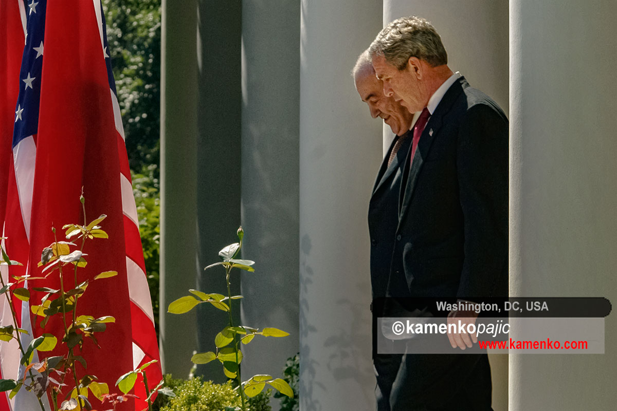 U.S. President George W. Bush and Iraq's interim Prime Minister Ayad Allawi walk into the White House Rose Garde
