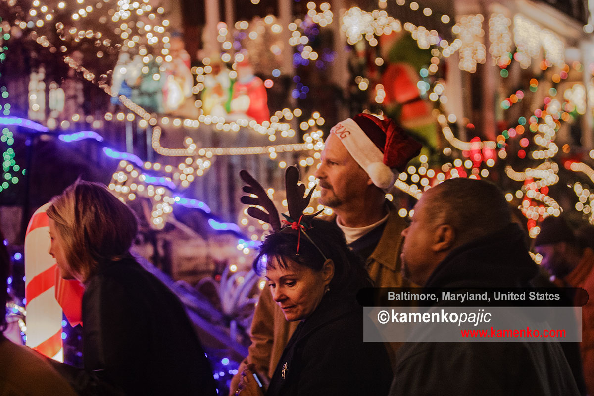 Visitor admire holiday decorations along the 700 block of 34th street