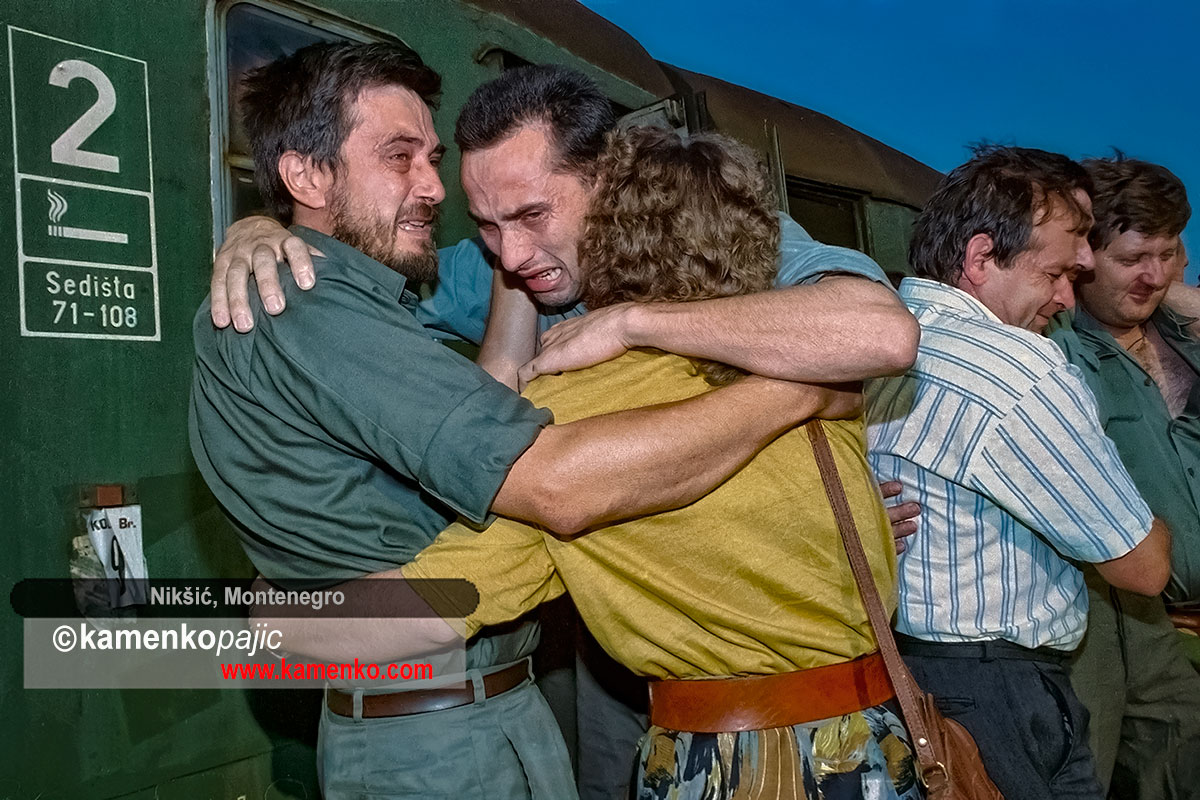 Family members welcome a soldier after his release from a prison camp