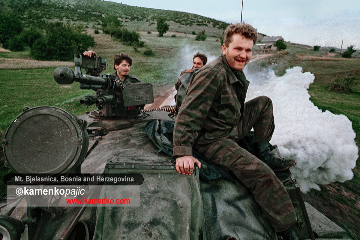 Bosnian Serb soldiers riding a tank near Mt. Bjelasnica